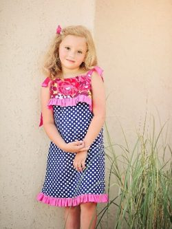Child's Play dress sewing pattern by Whimsy Couture. This girls dress pattern has a cute partial front overlay with ruffle. It works great for all seasons.